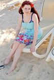 The girl in the beach chair Stock Image