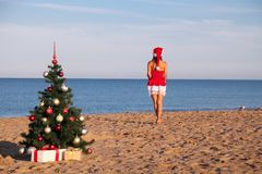 Girl on the beach on Christmas and new year at the resort. 1 Stock Photography
