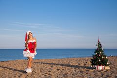 Girl on the beach on Christmas and new year at the resort. Girl in costume on the karnovalnom resort on Christmas new year Royalty Free Stock Image
