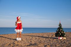 Girl on the beach on Christmas and new year at the resort Stock Photography