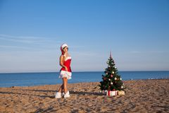 Girl on the beach on Christmas and new year at the resort. Girl in costume on the karnovalnom resort on Christmas new year Stock Photography