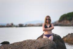 Girl at Beach at Dusk Stock Photos