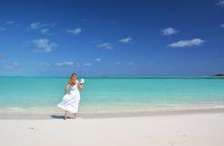 Girl on the beach of Exuma, Bahamas Stock Image