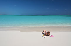 Girl on the beach of Exuma, Bahamas Royalty Free Stock Photos