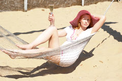 Girl on the beach in a hammock Royalty Free Stock Photography