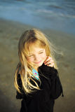 Girl at beach, hands clasped Stock Photo