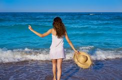 Girl with beach hat in sea in summer. Girl with beach hat in sea with summer white dress royalty free stock images