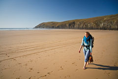 Girl on a beach. Hiker on one of the beaches on the Atlantic coast in Cornwall, UK Royalty Free Stock Images