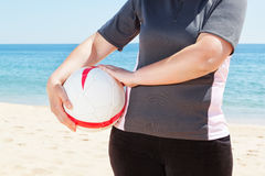 The girl on the beach holding a ball. Stock Images