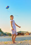 Girl on beach with kite Royalty Free Stock Photos
