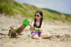 Girl on the beach. Little girl playing on the beach Stock Image