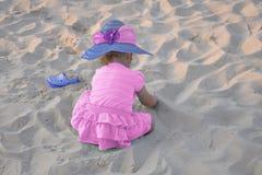 Little Girl on the Beach. A little girl playing on the beach Stock Photos