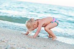 The girl on the beach Stock Photos