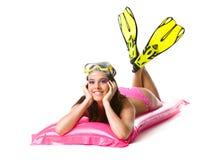 Girl on beach mattress Stock Photos