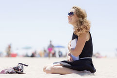 Girl on the beach with a notebook. Stock Photography
