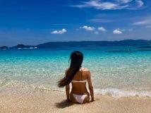 Girl at beach okinawa island. Girl summer holiday in beach stock photos
