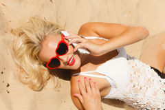 Girl on beach with phone. Royalty Free Stock Photo