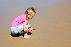 Girl beach play Royalty Free Stock Photo