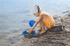 Girl on the beach plays Royalty Free Stock Images