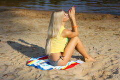Girl on the beach. Portrait of a beautiful girl in yellow t-shirt on the beach Stock Photography