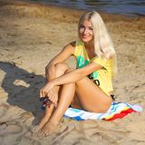 Girl on the beach. Portrait of a beautiful girl in yellow t-shirt on the beach Royalty Free Stock Image