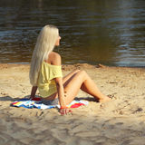 Girl on the beach. Portrait of a beautiful girl in yellow t-shirt on the beach Royalty Free Stock Photos
