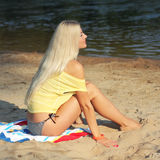 Girl on the beach. Portrait of a beautiful girl in yellow t-shirt on the beach Stock Photos