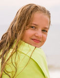 Girl on the beach - portraits. Girl with long blond hairs on the beach.  Jet ski in background Stock Photography