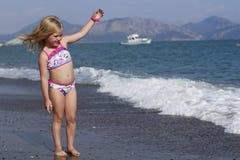 A girl on the beach. A pretty girl walking on the beach Stock Photo