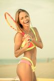 Girl on a beach with racquet Royalty Free Stock Images