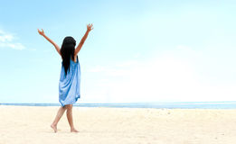 Girl at the beach raised her hands up Royalty Free Stock Photos