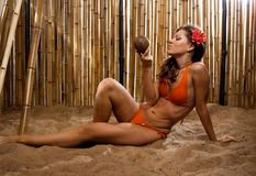 Girl on the beach with red flower Stock Photo