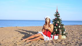 Girl on beach resort in Christmas clothes for the new year in the tropics 1 stock footage