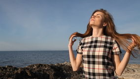 Girl on beach rocks and stones sea. Ocean stock video