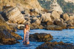 Girl on the water at the seashore royalty free stock photography