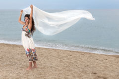 Girl on beach with scarf Stock Photography