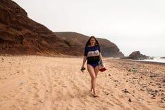 Girl, beach and sea in cloudy day. Girl, beach and sea in cloudy and foggy day Royalty Free Stock Images