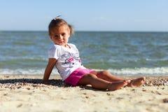 Girl on the beach by the sea Stock Photos