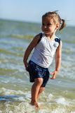 Girl on the beach by the sea Stock Image