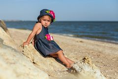 Girl on the beach by the sea Royalty Free Stock Image