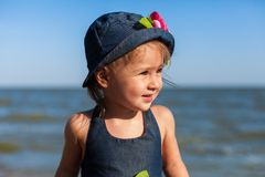 Girl on the beach by the sea Royalty Free Stock Photography