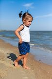 Girl on the beach by the sea Stock Photography