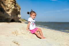 Girl on the beach by the sea Stock Photo