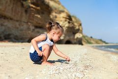 Girl on the beach by the sea Stock Images