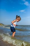 Girl on the beach by the sea Royalty Free Stock Images