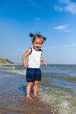 Girl on the beach by the sea Royalty Free Stock Photos