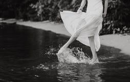 Girl beach sea splashing water her feet stock photo