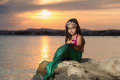 Girl on the beach and setting sun Stock Images