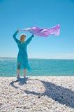 Girl on the beach shore Royalty Free Stock Photo