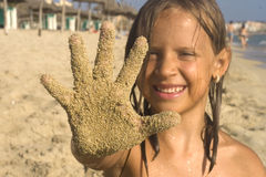 Girl on beach show her sands hand Royalty Free Stock Images